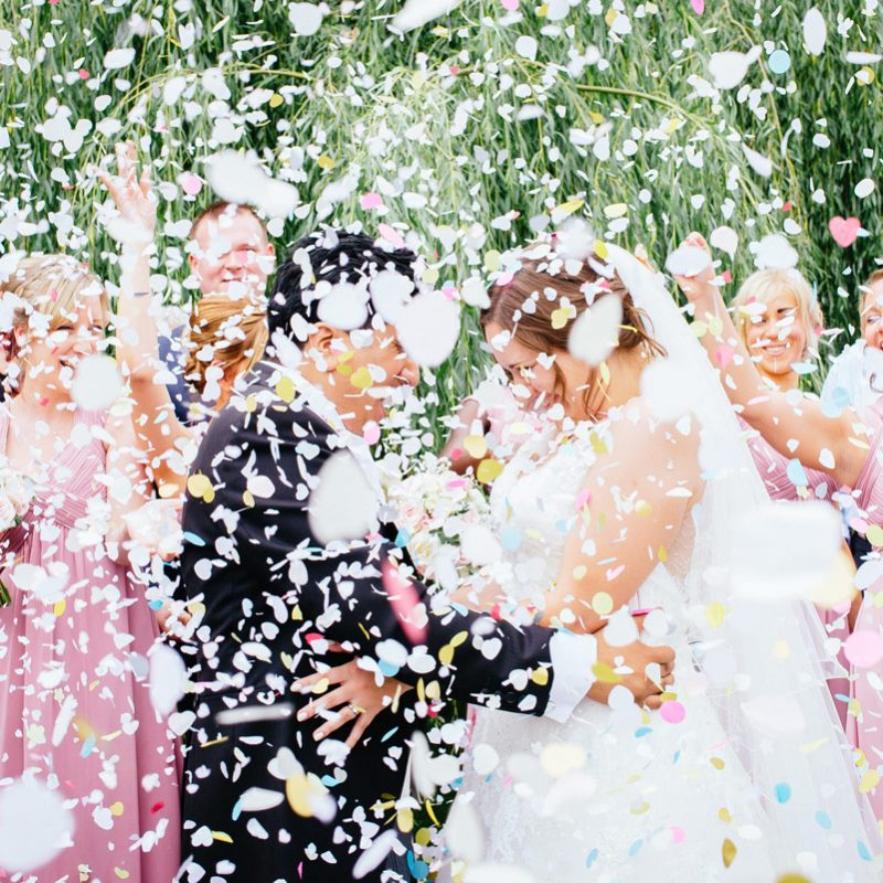 wedding bride and groom with lots of confetti at Blake Hall