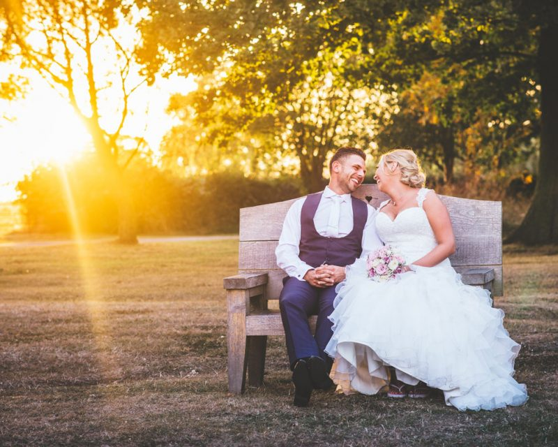 blake hall bride and groom on love seat at sunset