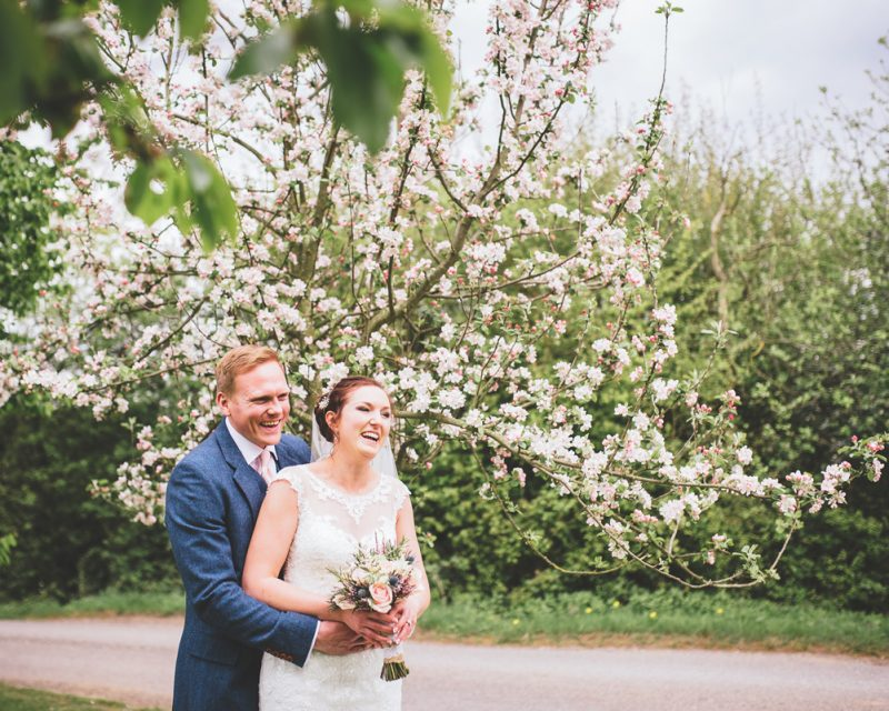 Bride and Groom with spring blossom tree