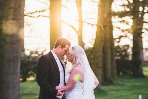 Bride and Groom on wedding day at sunset