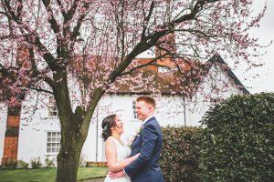 bride and groom spring wedding blossom tree