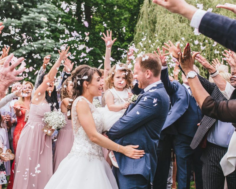 Bride and Groom during confetti throw at Blake Hall
